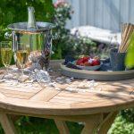 Burton Teaktisch und Champagnerkühler